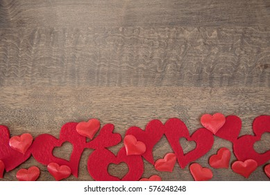 Variety of hearts on a wooden background with copy space