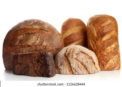Variety homemade half loaves of rye, wheat, whole grain and seeds bread on white background. Bakery close-up