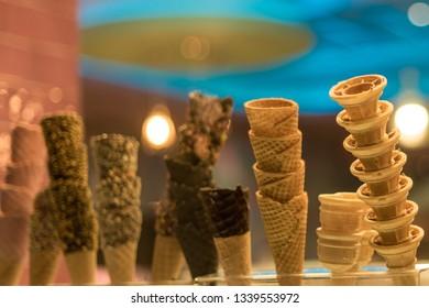 A variety of ice cream cones.