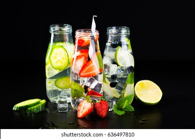 Variety of infused detox water isolated on black, health concept