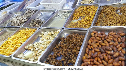 Variety of insect on the tray ready for sale at local store. In some places Chinese still eat cicadas, crickets, giant water beetles, stinkbugs, silk worms, cockroaches and fly maggots.