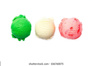 Variety of Italian icecreams with individual scoops of three different flavourings in green , pink and white lined up in a row isolated on white