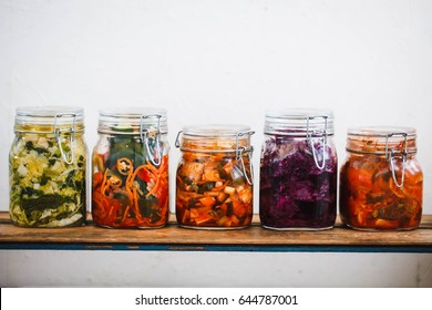 Variety kimchi masson jars. Korean Radish kimchi recipe, cucumber kimchi recipe, basic napa cabbage recipe. Winter canning food concept. Simple fermentation recipe.