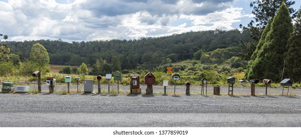Variety of mail boxes, including microwaves, ovens, fridges, frizers, containers, big boxes, small boxes, found along the New England Highway near Grafton, NSW, Australia