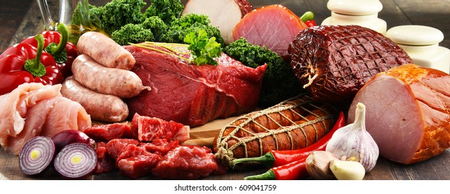 Variety of meat products including ham and sausages.