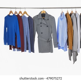 Variety of Men suits and shirts ,coat on hangers