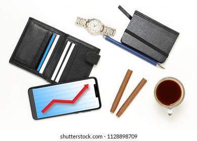 variety of men's objects on white, phone with graph, business success concept