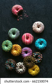 Variety of mini American donuts on dark background