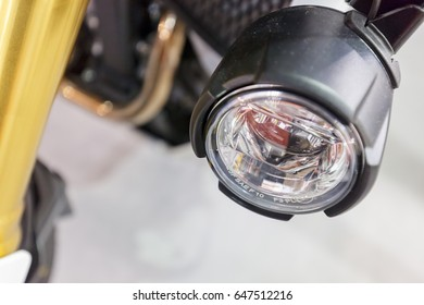 a variety of motorcycle parts, note shallow depth of field