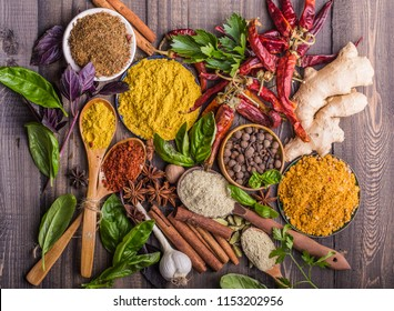 Variety of natural Georgian spices, seasonings and herbs  - khmeli suneli, paprika, curry, coriander, cardamom,pepper, chili, cinnamon, cloves, star anise, Svan salt