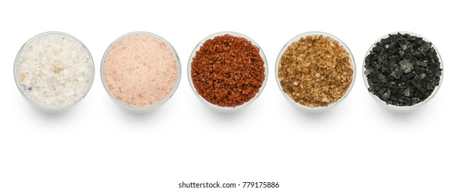 variety of natural and spicy salt on white background