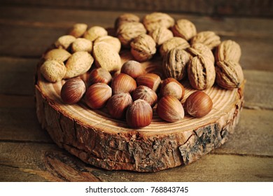 Variety of nuts on wood
