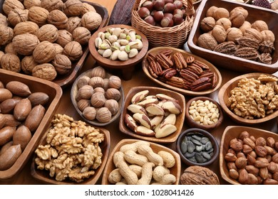 A variety of nuts in wooden bowls. Healthy food.
