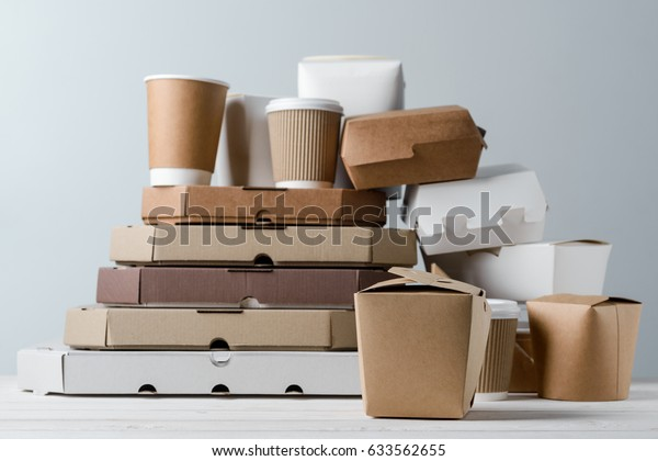 db11271d8b3 Variety of paper take-out food containers, pizza boxes and coffee cups,  close
