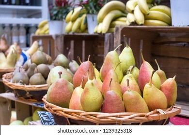 Variety of pears on sale in baskets at Eataly high-end food market in Turin, Italy.