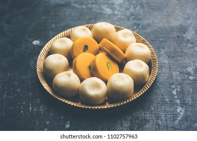 Variety of Peda / Pedha in different flavours and colour. Served in a bowl or plate. It's a popular festival food from India. selective focus