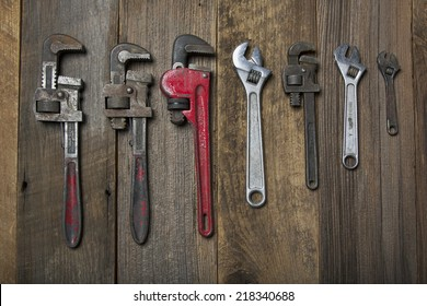 A variety of pipe wrenches in a line