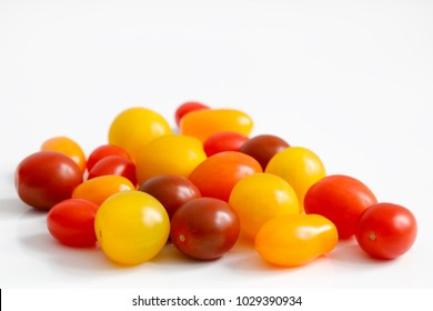 Variety of plum, grape, cherry, small tomatoes with red, orange and yellow colors with copy space to top