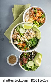 Variety of poke bowls with tuna, salmon and tofu on rice with vegetables