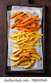 Variety of potatoes for garnish: potato wedges, french fries, sweet potato on brown background