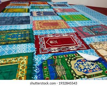 Variety prayer mat on the floor.