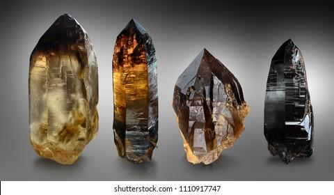 A variety of quartz crystals from Moravian Highlands including citrine, smokey quartz and morion.