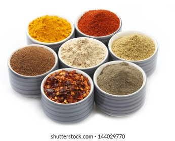 Variety of raw Authentic Indian Spice Powder on bowl. Focus on Cinnamon Powder in full-frame.