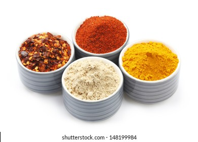 Variety of raw Authentic Indian Spice Powder on bowl isolated in white background.