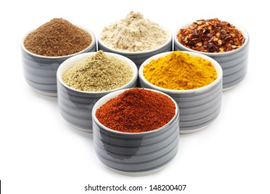 Variety of raw Authentic Indian Spice Powder on bowl.