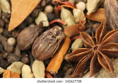 Variety of raw Authentic Indian Spices background. Focus on Star Anise in full-frame.