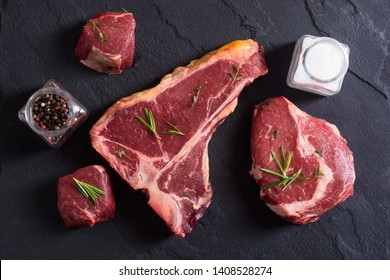 Variety of raw beef meat steak . T-bone , ribeye and fillet mignon . Black angus