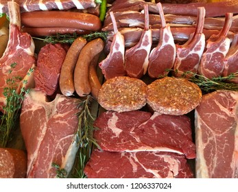variety of raw meat as a background