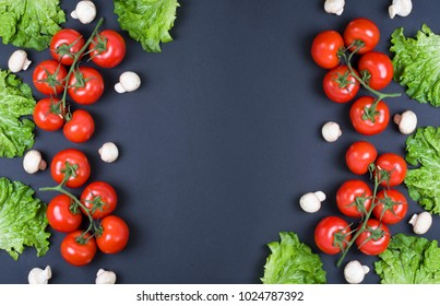 Variety of raw vegetables, culinary concept. Assortment of vegetables and herbs on grey stone background. Top view. Copy space. Different raw vegetables and spices on black background. Healthy eating.