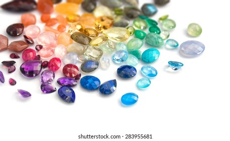 Variety of real colorful precious gems: blue topaz, emerald, ruby, moonstones, labradorites, amethyst, rose quartz, tiger eye, peridot,aquamarine, sapphire, citrine, lapis lazuli, fluorite and more