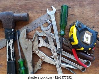 Variety of repair tools on wooden background, Old tools renovation, Repair tools.