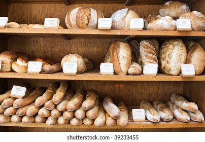 A variety of rustic loaves at a bakery in Quebec.