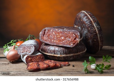 Variety of sausage products with vegetables