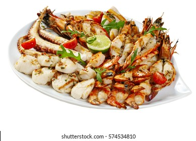 A variety of seafood grill on a large platter. King prawns, crab phalanges, scallops, langoustines, octopus