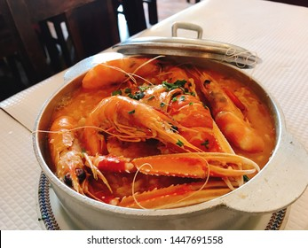 Variety seafood stew with rice in the silver hotpot