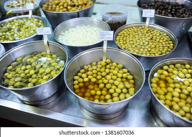 Variety of seasoned olives, pickles in the market of Triana, Seville, Spain