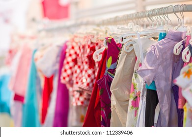 Variety of shirts, trousers, dresses in kids mall