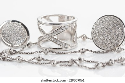 variety of silver jewelry : rings, earrings and pendant
