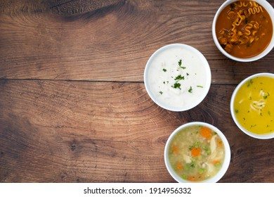 A Variety of Soups on a Wooden Table with Room for Copy