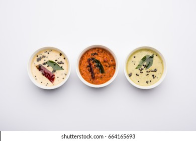 Variety of South Indian Chutney like coconut, tomato and min served in bowsl, selective focus