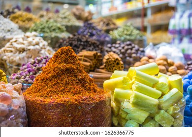 Variety of spices and herbs on the arab street market stall. Dubai Spice Souk, United Arab Emirates.