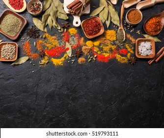Variety of spices and mediterranean herbs. Food background. Top view with copy space