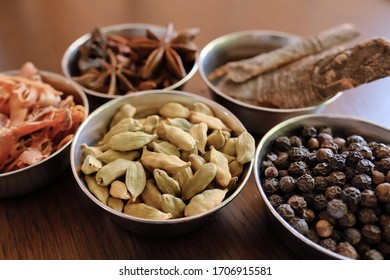 Variety of spices on a old wooden table