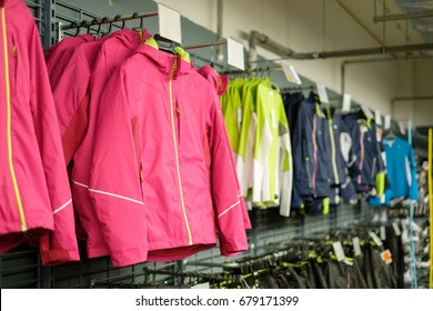 Variety of sport jackets on hangers in outdoor sports supermarket