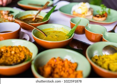 Variety of Sri Lankan curry in bowls on table
