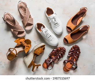 Variety of summer women's shoes - sneakers, sandals, roman sandals, slippers on a light background, top view